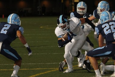 Farbod Memarian (Jr.) makes a tackle. (M.Chinn)