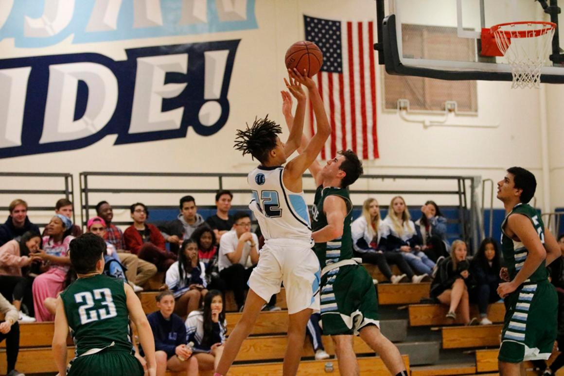 Boys Basketball still alive for league title with Irvine win