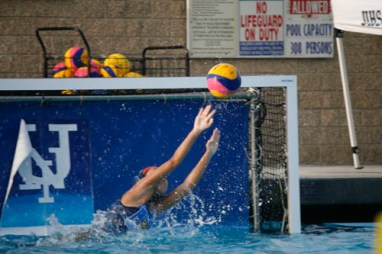 Laura Yang (Sr.) dives to save the ball. (F.Duffy)
