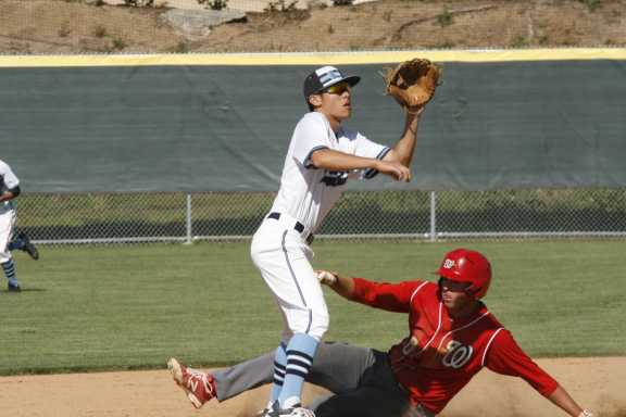 Standing on second base, John Rizzo (Jr.) prepares to catch the ball to send Woodbridge out (A. Li)