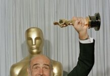 "In this file photo dated April 11, 1988, Sean Connery holds up his best supporting actor Oscar for ""The Untouchables"" at the 60th annual Academy Awards in Los Angeles, Ca., USA. Scottish actor Sean Connery, considered by many to have been the best James Bond, has died aged 90, according to an announcement from his family. (AP Photo/Lennox McLendon, FILE)"