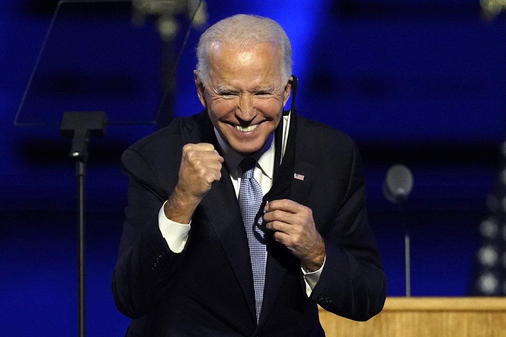 President-elect Joe Biden gestures to supporters Saturday, Nov. 7, 2020, in Wilmington, Del. (AP Photo/Andrew Harnik)