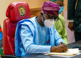 Lagos State Governor, Mr. Babajide Sanwo-Olu, signing the Year 2021 Appropriation Bill into Law at Lagos House, Marina, on Thursday, December 31, 2020.