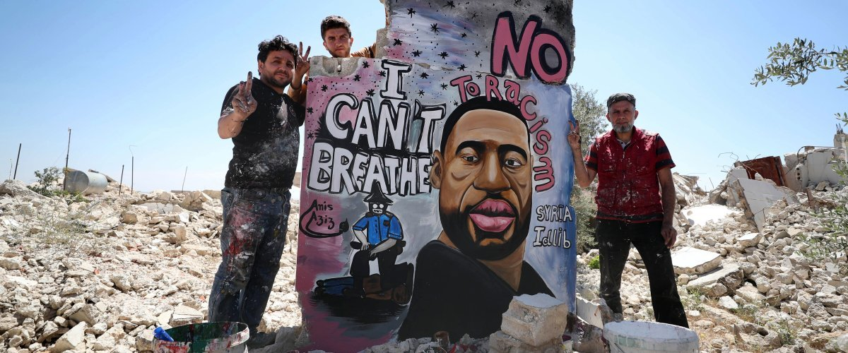 In Solidarity and as a Symbol of Global Injustices, a Syrian Artist Painted a Mural to George Floyd on a Bombed Idlib Building