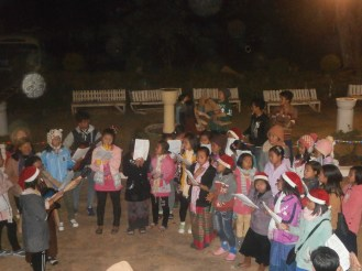 Another group of locals were caroling outside the S.A.G. House