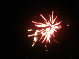 A red firework in welcoming the new year