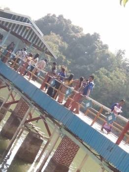 Hey! I'm on the bridge with a lot of people walking on it
