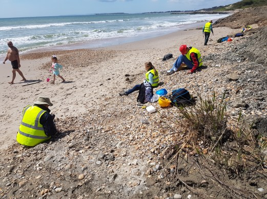 Rootling in the shingle for Shark Teeth