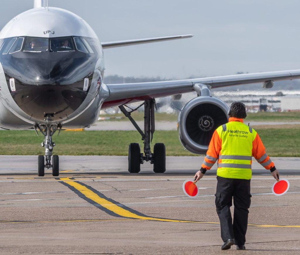 BEA Airbus A319 G-EUPJ gets marshalled into position at Heathrow (Image: Jamie Woodhouse-Wright/Aviation Media Co.)