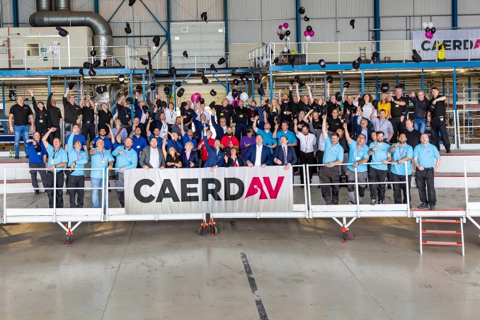 Caerdav's engineering and training teams celebrate the new company name.
