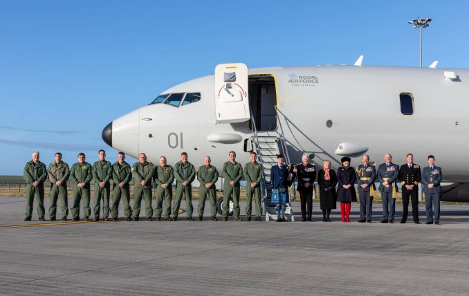 The Poseidon crew and VIPs stand in front of the new RAF P-8A Poseidon. (©Crown Copyright 2020)
