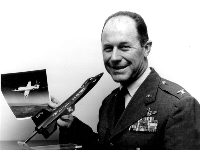 USAF-Col. Charles S. Yeager, Commandant of the USAF Aerospace Research Pilot School at the Air Force Flight Test Center, Edwards AFB, Calif., poses with a model of the North American X-15 high speed, high-altitude research aircraft.  he holds a photograph of the Bell X-1 aircraft in which he became the first man to fly faster than the speed of sound on Oct. 14, 1947.