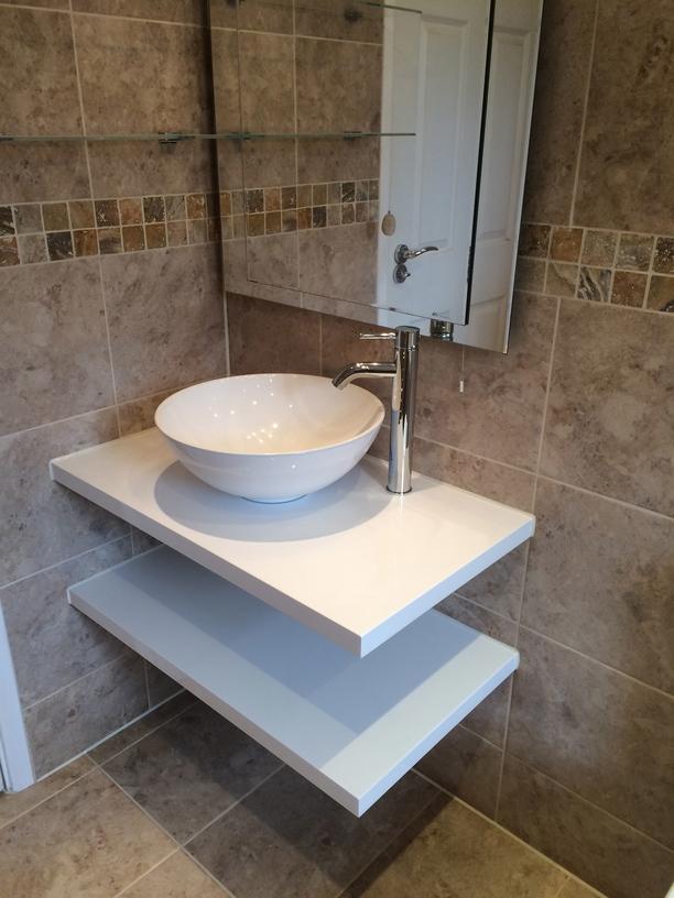 fitting a wall hung basin in a bathroom