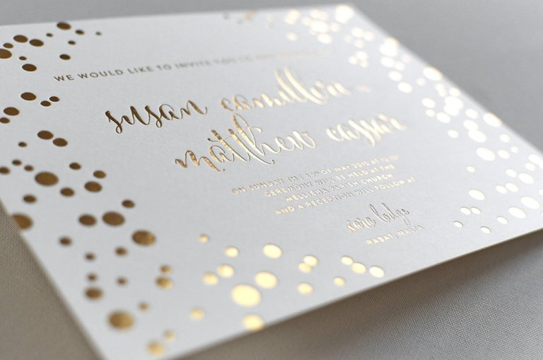 Gold embossed into wedding invitations