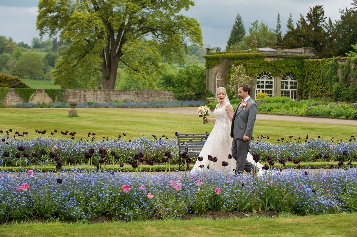 Walk the flowery aisles in the garden at this lovely venue.