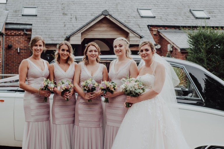 How unique are these bridesmaids dresses! And the bridal gown too is incredible.