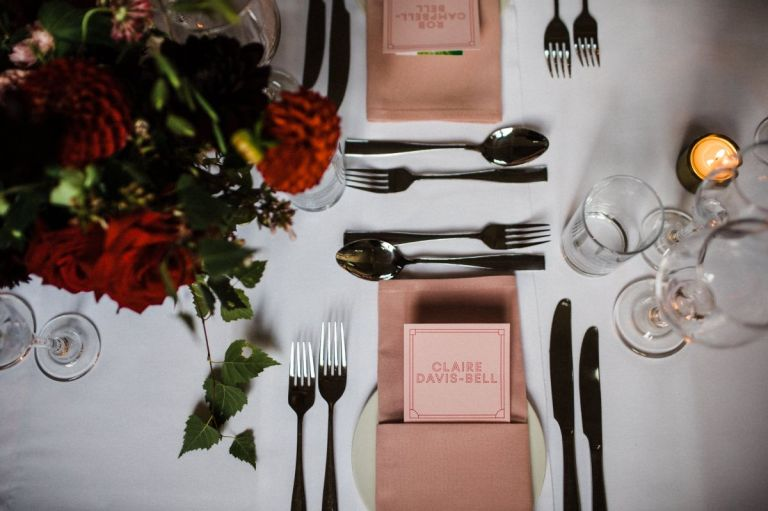 Such cute table settings! Love this wedding!
