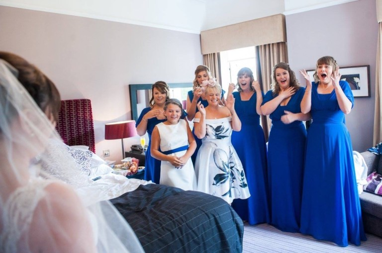 Got to love a bridal party's first reaction to the dress!