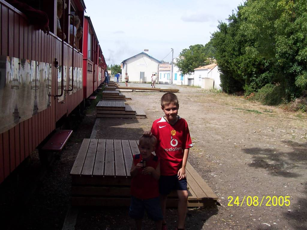 two boys stood by a train