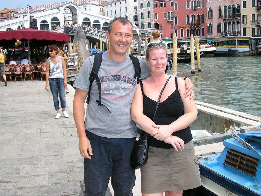 a couple by Rialto Bridge