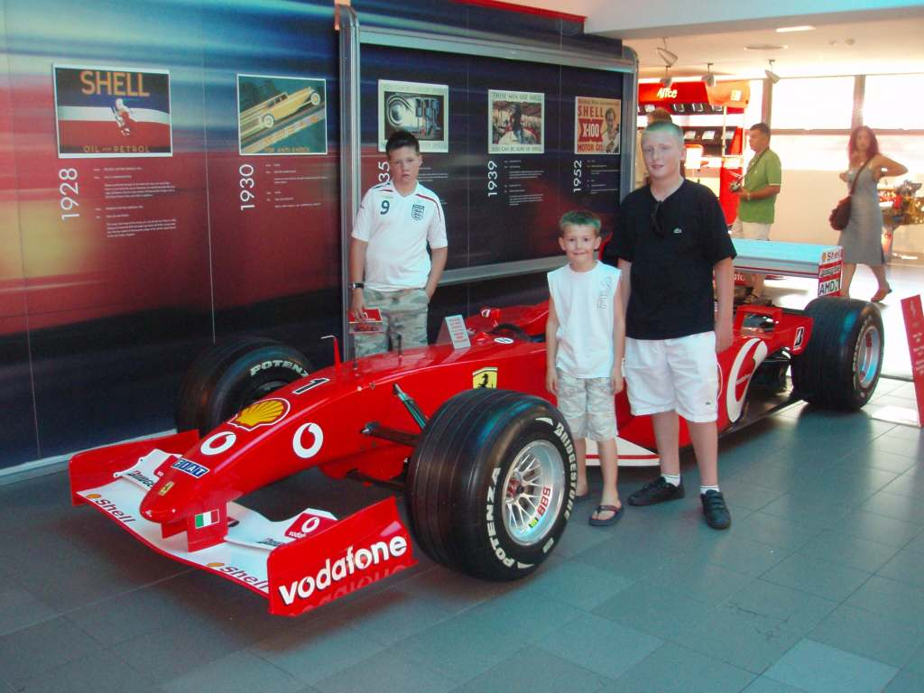 3 boys with a Ferrari F1 car