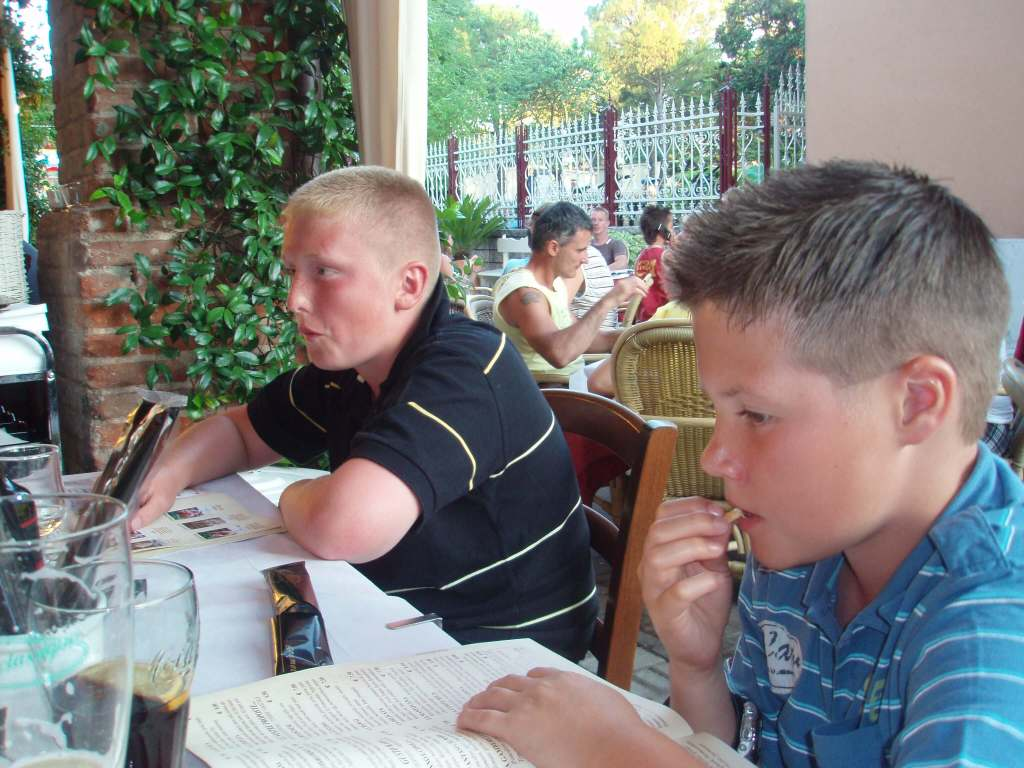 two boys waiting to eat