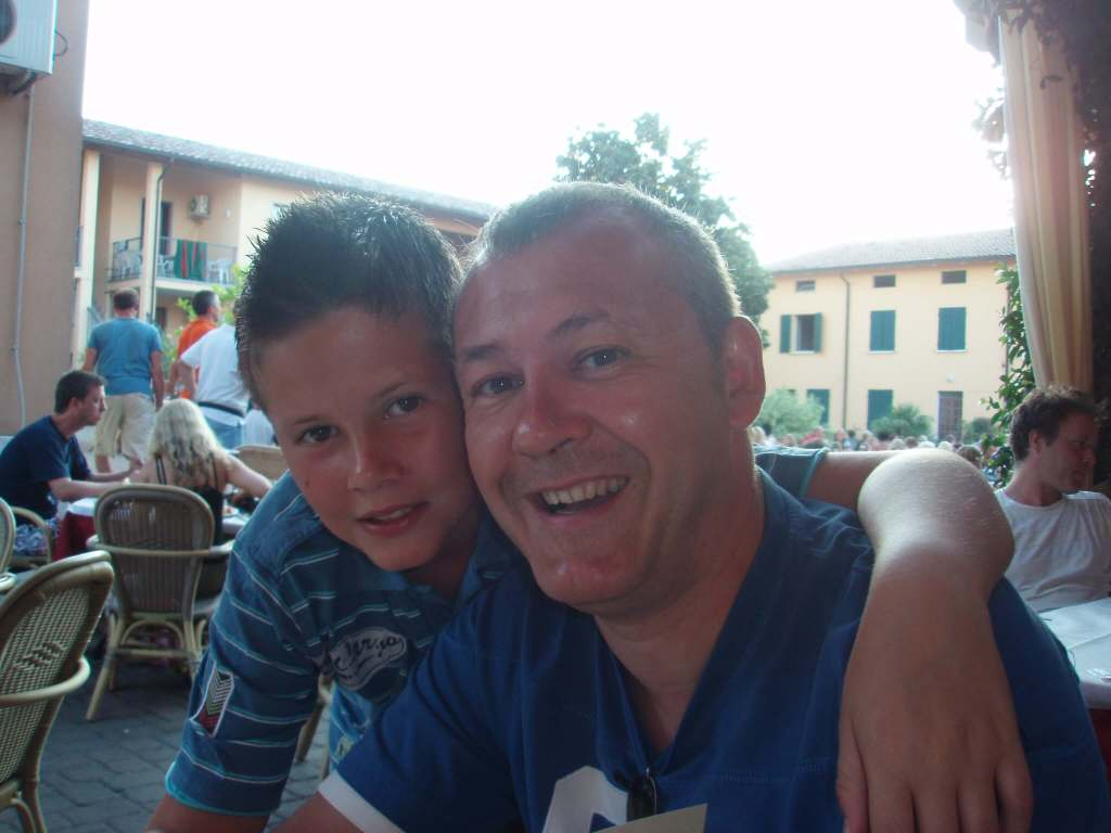 a boy & his father at Bella Italia