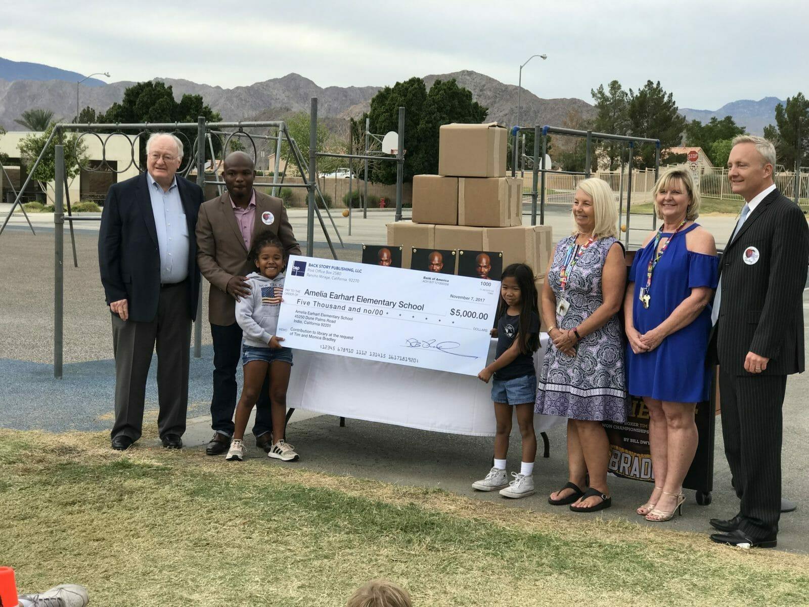 Tim Bradley Donates 5 000 For School Library