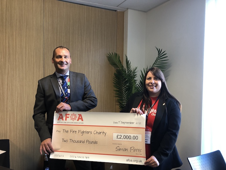 AFOA Chairman Simon Petts presenting a cheque for £2,000 to Kerry James of The Fire Fighters Charity. (AFOA)