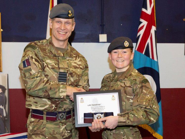 FIRST FEMALE GUNNER GRADUATES RAF REGIMENT