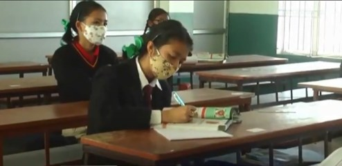 Students attending class as schools and colleges in Manipur reopened on Wednesday 2