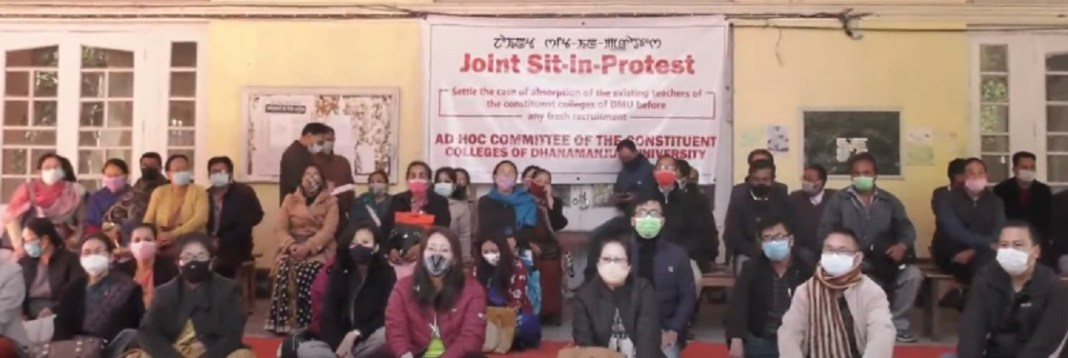 Teachers of DM University staging sit in protest at DM College campus in Imphal on Wednesday 2