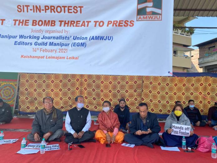 MLA AK Meerabai and MHRC acting chairman Kh Mani taking part in scribes protest against bomb threat to media staged in Imphal on Sunday