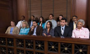 Jurors sit in a court setting