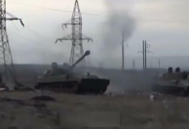 Стрельба на Донбассе. Фото: скрин youtube