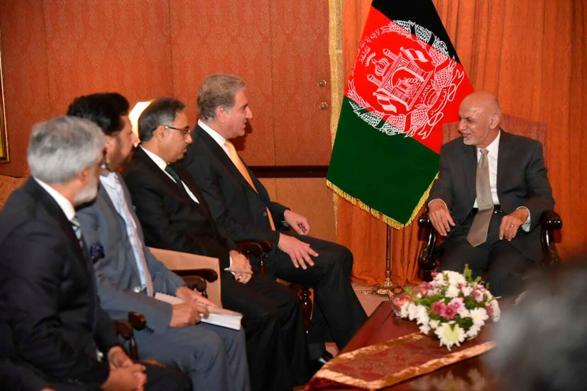 In this photo released by the Foreign Office, Pakistani Foreign Minister Shah Mehmood Qureshi, second from right, talks with visiting Afghan President Ashraf Ghani in Islamabad, Pakistan, Thursday, June 27, 2019. Ghani has arrived on his first visit…