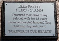 Engraved memorial plaque on black backing board.