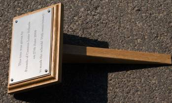 Engrave plaque on a backing board with small tree stake