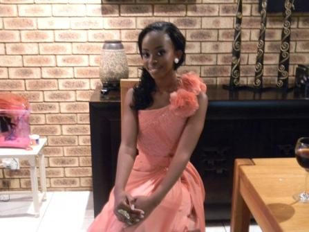 Nandi's brother takes a picture of her in her dining room. She thought she could squeeze in a few pictures before her friends arrived for a pre-drinks celebration. She was still in awe of the transformation that was a result of months of preparation.