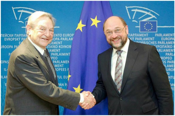 Martin und George besiegeln per Handshake die Zukunft Europas. Der Inter National Sozialismus unter dem Banner der 12 Sterne Israels.