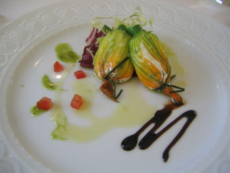 Ricotta-stuffed zucchini blossoms with balsamic reduction.