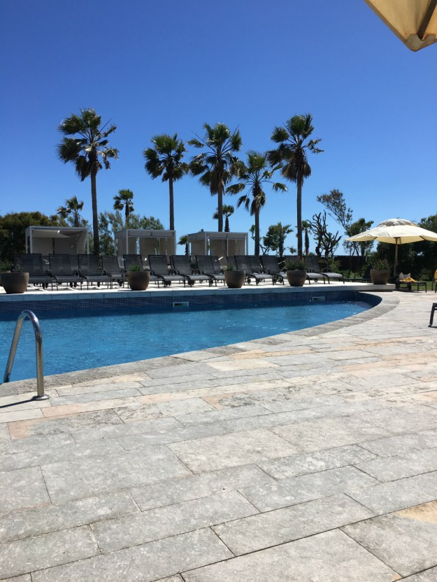 Pool at the AC Gava Mar in Spain. We were looking for a good hotel near the Barcelona airport and this more than delivered! Click to view this and our full 10-day honeymoon in Spain.