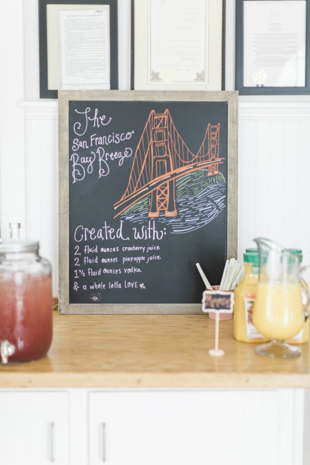 A beautiful hand lettered signature cocktail sign for a bridal shower. This one features the San Francisco Bay Breeze with an illustration of the Golden Gate Bridge. A Yacht Club Nautical Bridal Shower | Ultimate Bridesmaid | Kelly Sea Images