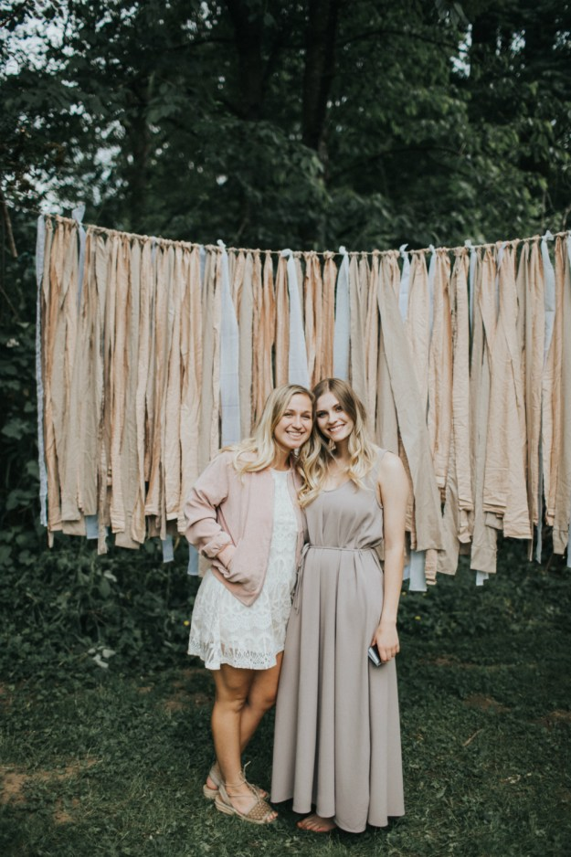 A simple DIY photo booth: Just tie neutral ribbons to a clothesline. A Bohemian Bridal Shower in the Garden | Ultimate Bridesmaid | Alyssa Wilcox Photography