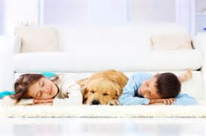 kids and pet laying on carpet
