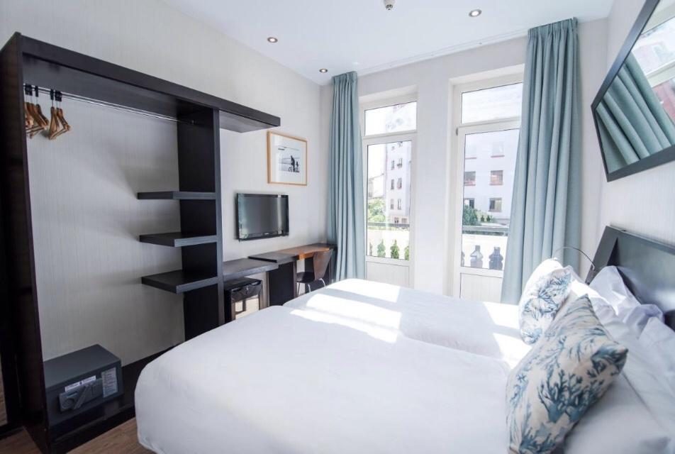 Quarto do Hotel Pétit Palace em Rusafa é uma boa dica de onde se hospedar em Valência