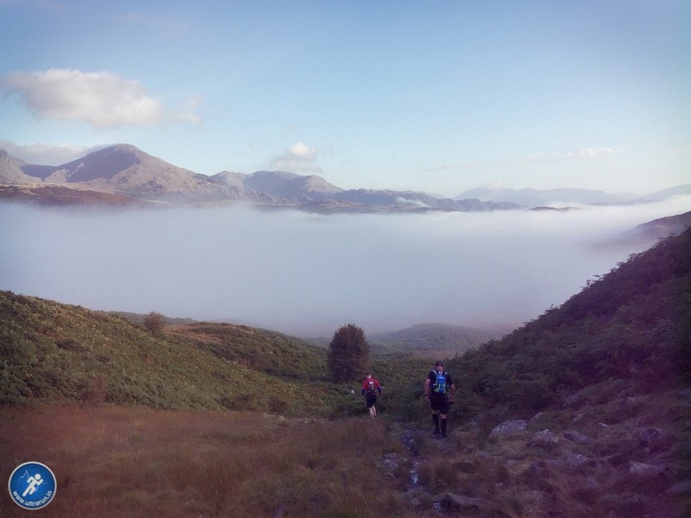 Descending into the mist with Coniston Fells in the distance