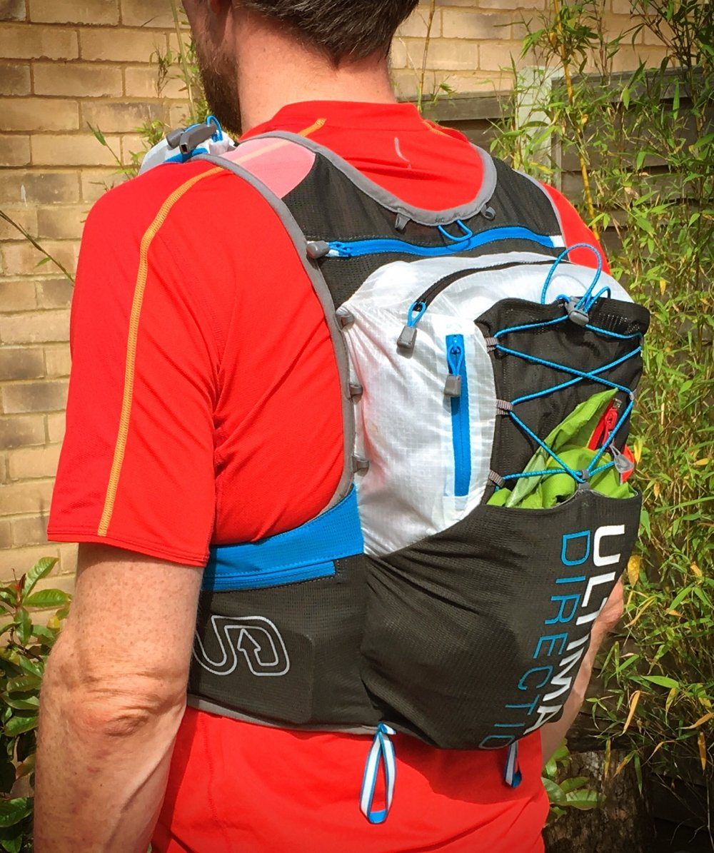 Rear view of the Ultimate Direction PB Adventure Vest 3.0, with the main compartment fully loaded.