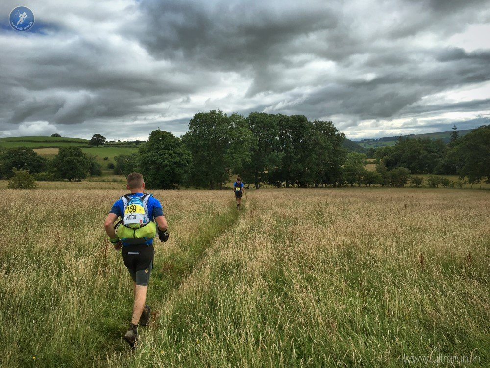 Past halfway, running through fields towards Dalemain and the bag drop
