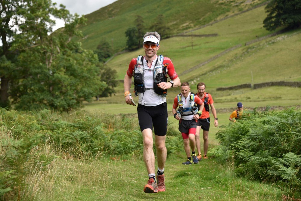 Giles still smiling and running up Fusedale with Andy and Henry behind. Photo courtesy of SportSunday